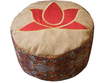 Meditation cushion. Red lotus on ochre velvet surface.