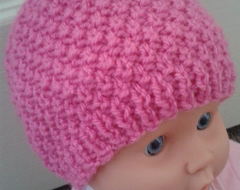 Pink beanie hat knitted for a baby girl. Size 0-3 months.