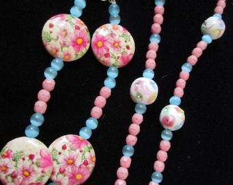 "Beaded""STATEMENT"" eyglass holder pink and blue with flowers"