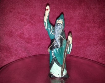 The is a small Wizard (cone) incense burner.