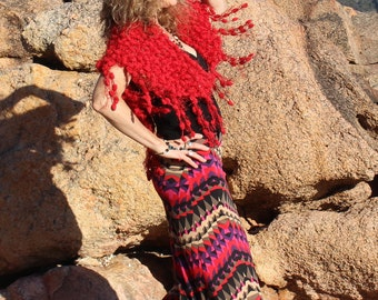 red knitted shawl with a shimmer through it.