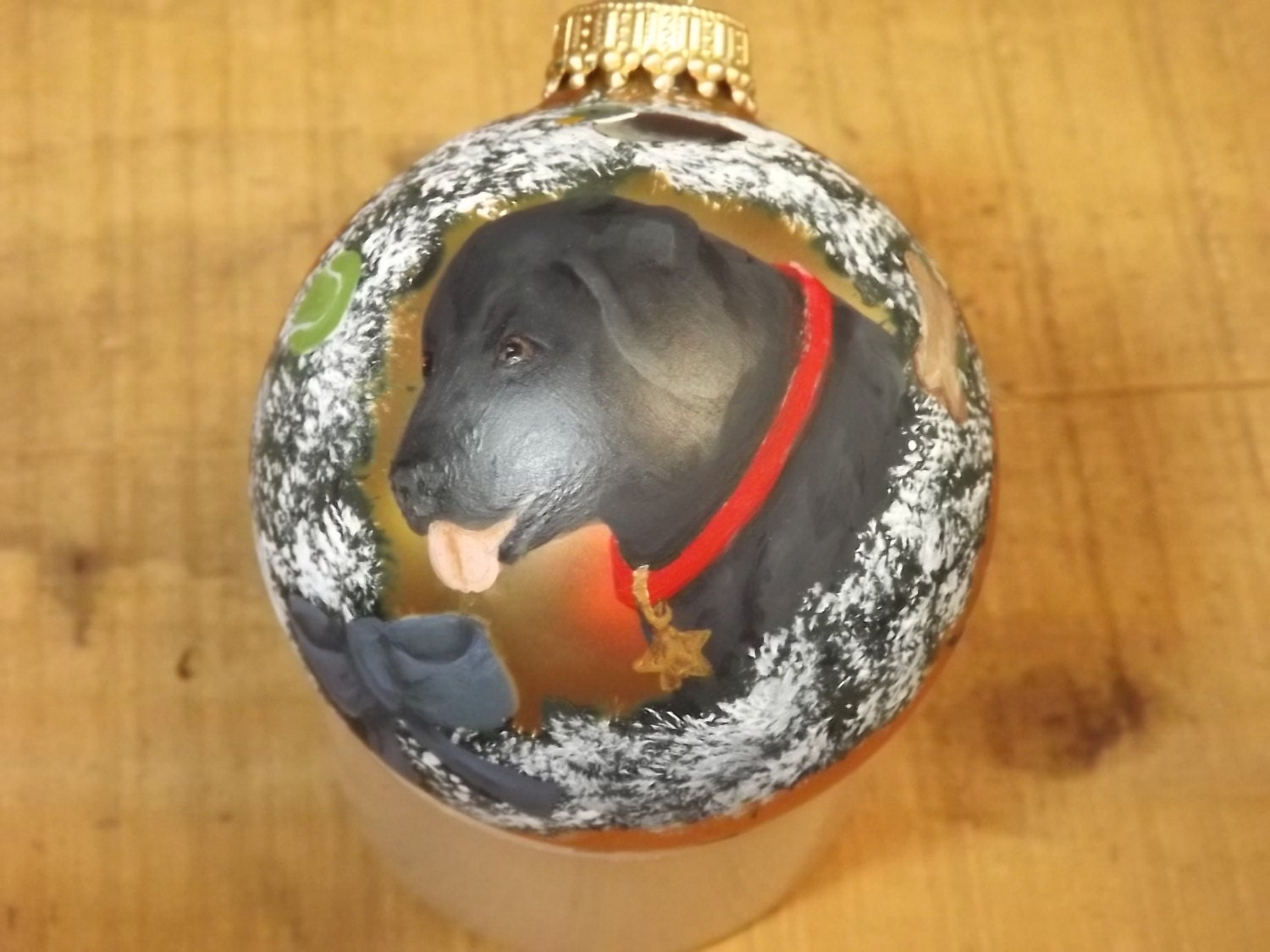 Black Lab with dog toys on wreath hand painted on gold glass ornament Labrador Retriever