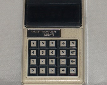 Commodore U.S. * 4 portable battery powered calculator