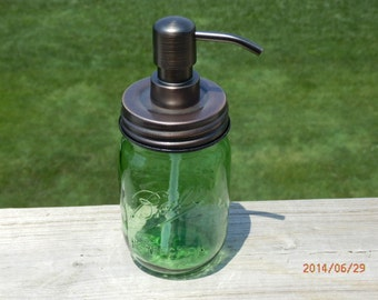 One-Handcrafted Green mason jar soap/lotion dispenser with High Longevity metal pump and choice of Primitive Lid and Bird Head pump color.