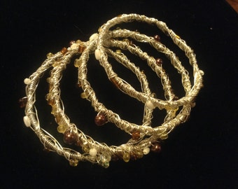 Set of Four Wired Bangles with Beading