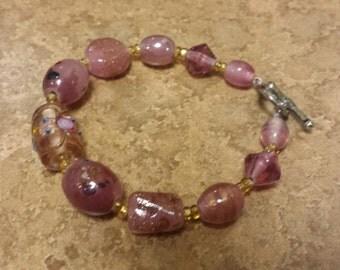 Pink and gold lampwork bracelet