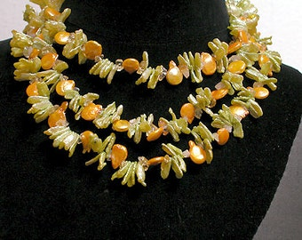 Cafe Society Collection Necklace:   Orange and Green Pearls