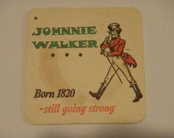 Vintage Johnnie Walker Born 1820 Still going strong drink coaster. Used