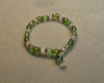 Green and clear glass bracelet