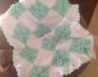 Knitted baby cot blanket