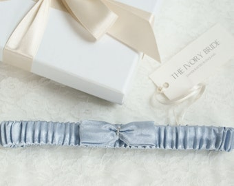 Victoria blue-grey satin garter with satin bow detail.