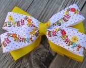 Grosgrain yellow and printed Easter ribbon hair bow.