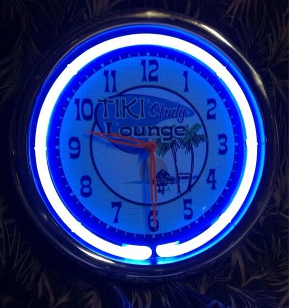 Neon Retro Tiki 11 Wall Clock The cool blue by mymidcenturyliving