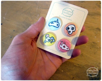 4 Skull Pinback Button Pack of a unicorn, an oh man, some ram creature, and a dragon thing