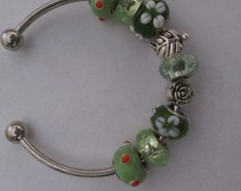 Bracelet-green beads on a cuff