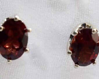 Garnet Sterling Silver 7 by 5mm Oval Stud Earrings