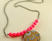 Hand printed wood pendant with neon pink beads necklace