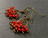 Wire wrapped chandelier earrings in red seed beads and antique brass wire.