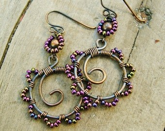Bead Dance earrings in Iris Purple mix - wire wrapped antiqued copper hoops with seed beaded petals