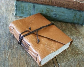 "Leather Journal . ""I wish I could write as mysterious as a cat"" -Edgar Allan Poe . handbound . tan (320 pgs)"