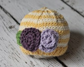 Newborn knit soft yellow and cream stripe hat with lavender and plum flowers