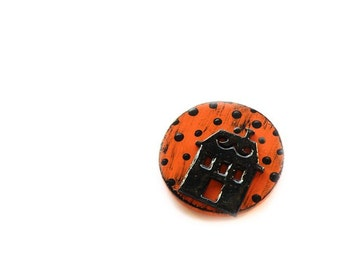 Halloween wooden brooch with black house on orange circle
