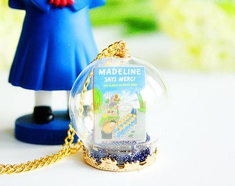 Madeline book cover in Terrarium glass globe necklace