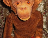 Vintage Battery Operated Toy Monkey who Shakes a Dice Cup.  Y-192