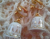 Divine Avon signed, Clip on white porcelaine with gold etched vintage Bell earrings, goldtone metal,