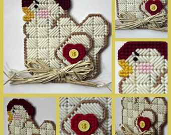 Country Chicken layerd magnet made in plastic canvas adorned with a red heart, yellow button and a raffia bow