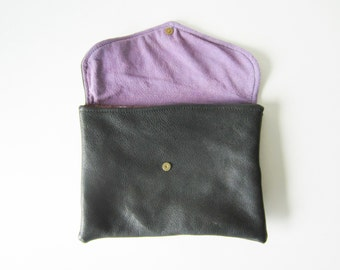 handmade eco-chic black leather clutch with purple interior