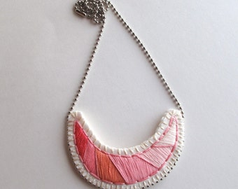 Pink necklace geometric hand embroidered geometric crescent shaped on cream felt with silver ball chain