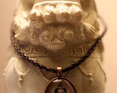 Buddha tea-toned cyanotype photo pendant, under glass on brown faux leather cord necklace