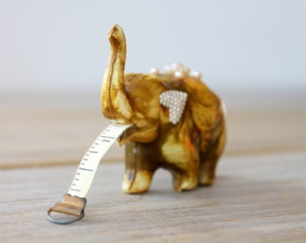 Elephant novelty vintage tape measure / mid century kitsch / yellow brown plastic elephant / faux pearls / eclectic decor collectible animal