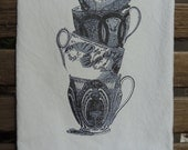 Charming Stacked Blue and White Tea Cups Design on White Flour Sack Towel Trimmed with Crisp Navy Blue Rick Rack