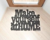Make yourself at home. Doormat with customizable sign