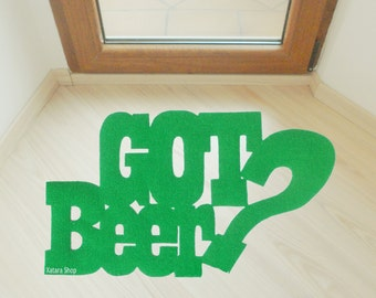 "Doormat. Rug with a customized message. ""Got beer?"""