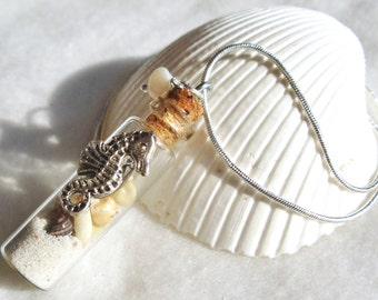 Glass vial seahorse necklace filled with beach sand and tiny seashells