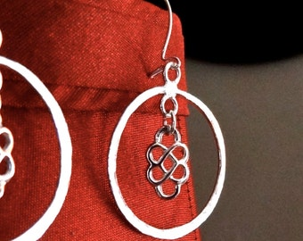Sterling silver plated earrings- lightly hammered dangling circles with centered dangling silver plated charm by Third Time's A Charm