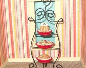 Miniature dollhouse black metal bakers's rack with sweets