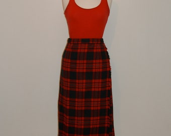 A classic 1950s  pleated tartan vintage skirt in red, green & white- new with tags