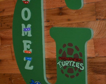 teenage mutant ninja turtles theme 18 inch wooden letter hangs on wall or your front door