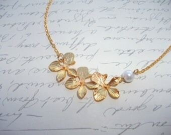 Gold orchid necklace with pearl