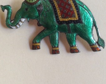 Incredibly detailed enameled elephant with gorgeous colors on sterling silver.