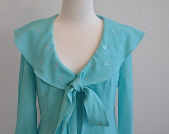 Aqua 60's/70's knee length frock with silver highlights