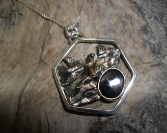 Hexagonal sterling silver pendant oxidized seam of an oval onyx