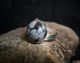 Sterling silver ring set with a snow flake Obsidian