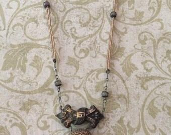 beaded stalagmite pendant with vintage metal