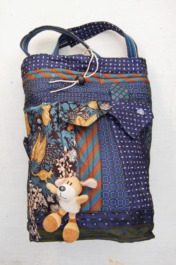Сумка-рюкзак ручной работы в технике patchwork с вышивкой и аппликациями.