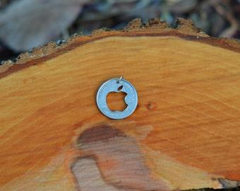 Apple logo hand cut coin